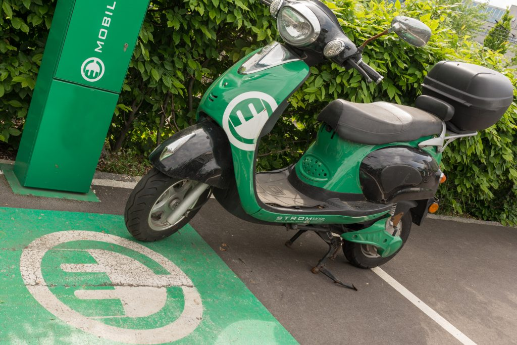 An electric scooter being charged.